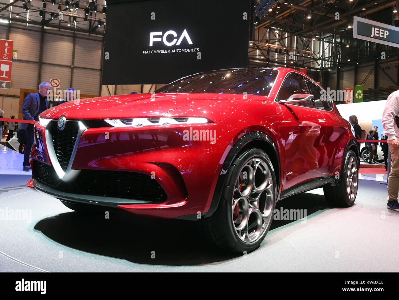 """Genf, Switzerland. 05th Mar, 2019. At the Geneva Motor Show, the Alfa Romeo Tonale will be presented on the first press day. In the background you can see the writing """"FCA Fiat Chrysler Automobiles"""", to which Alfa Romeo belongs. The 89th Geneva Motor Show starts on 7 March and lasts until 17 March. Credit: Uli Deck/dpa/Alamy Live News Stock Photo"""
