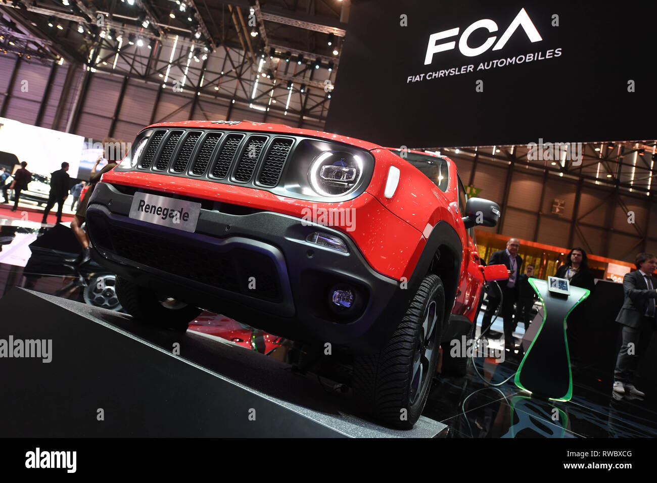 """Genf, Switzerland. 05th Mar, 2019. A Jeep Renegade 4x4 e is presented at the Geneva Motor Show on the first press day. In the background you can see the writing """"FCA Fiat Chrysler Automobiles"""", to which Jeep belongs. The 89th Geneva Motor Show starts on 7 March and lasts until 17 March. Credit: Uli Deck/dpa/Alamy Live News Stock Photo"""