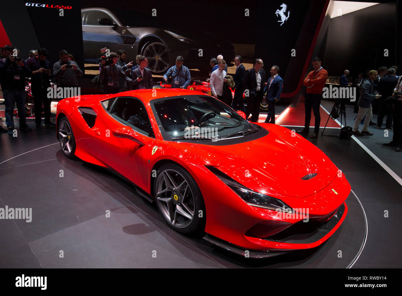 Geneva, Switzerland. 5th Mar, 2019. A new Ferrari F8 Tributo is seen on the first press day of the 89th Geneva International Motor Show in Geneva, Switzerland, March 5, 2019. Featuring about 220 world exhibitors, the 89th Geneva International Motor Show will be opened to the public from March 7 to 17. Credit: Xu Jinquan/Xinhua/Alamy Live News - Stock Image