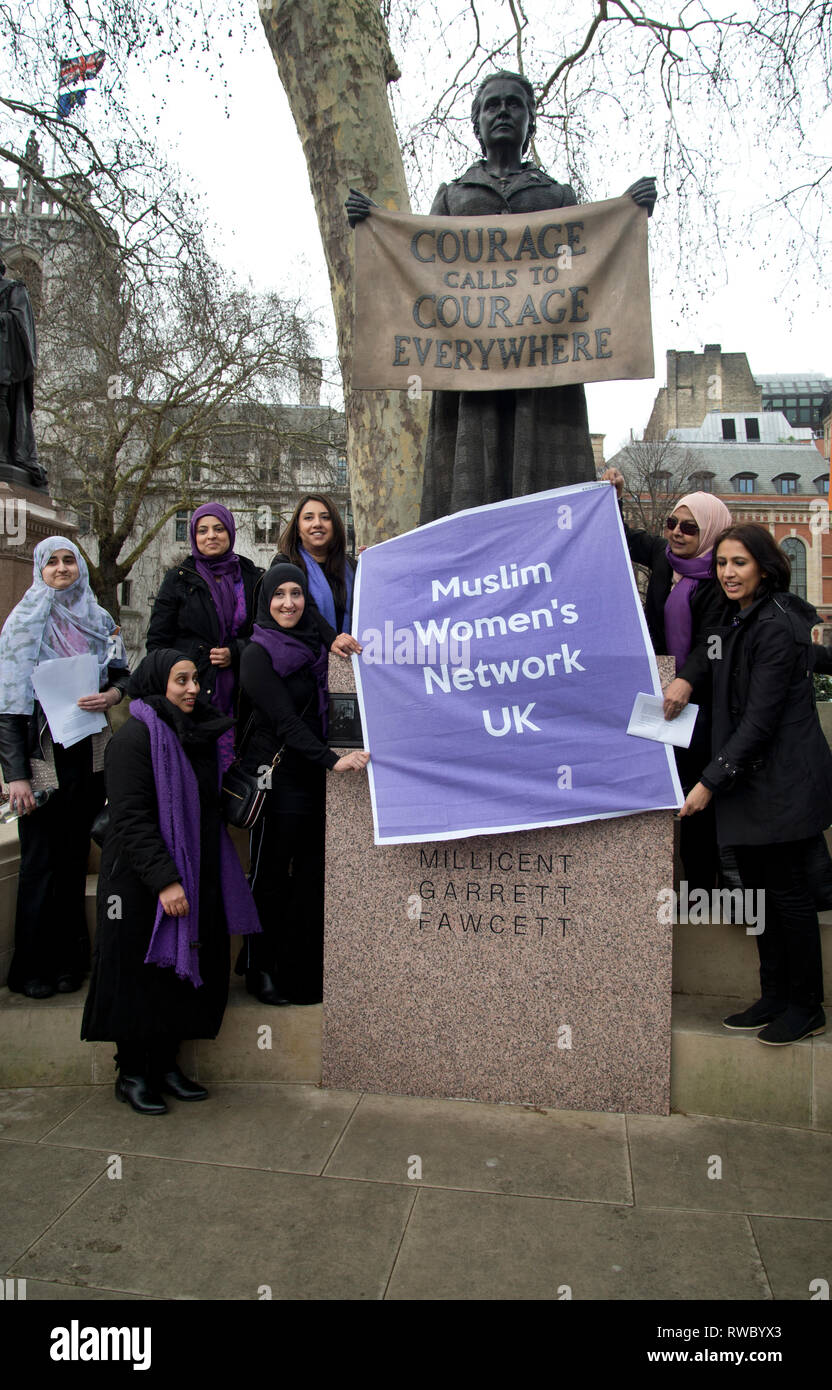 London, UK. 05th Mar, 2019. Parliament Square, Westminster, London. Ahead of International Women's Day, a group of women from the Muslim Women's Network UK pose in front of the statue of suffragette Millicent Garrett Fawcett Credit: Jenny Matthews/Alamy Live News Stock Photo