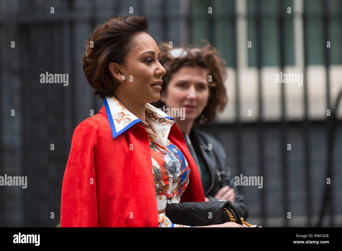 Downing Street, London, UK. 5th Mar 2019. Ex Spice Girl, Melanie Brown, known as Mel B, departs number 10 Downing Street accompanied by her staff.  Credit: Stephen Chung / Alamy Live News - Stock Image