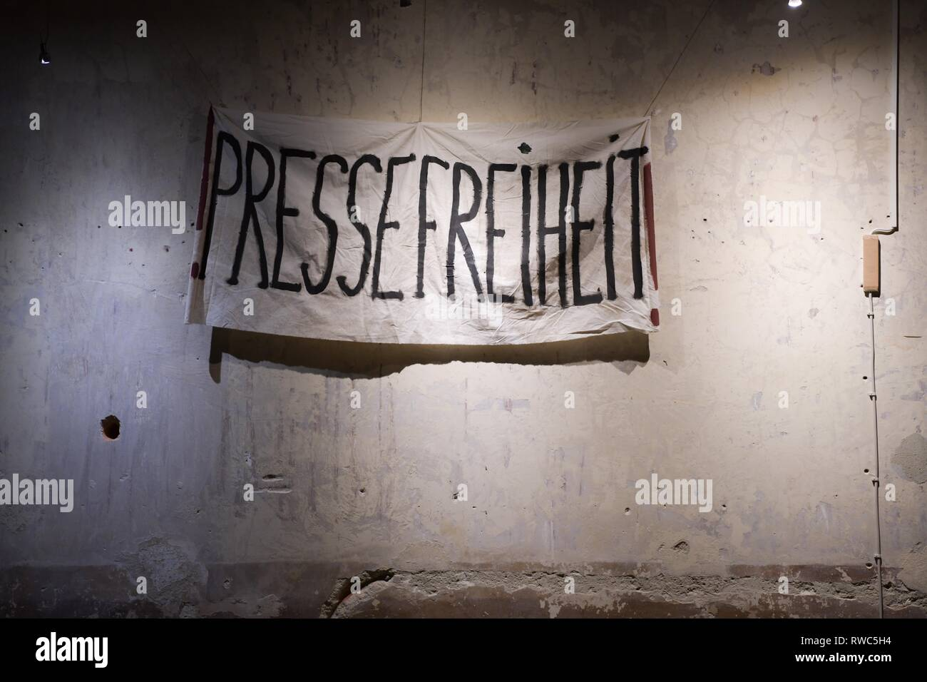 Berlin, Germany. 05th Mar, 2019. A banner with the inscription 'Pressefreiheit' can be seen during the shooting of the historical ZDF three-part film 'The Wall' in the Gethsemanekirche. The three-part film will be broadcast on ZDF in autumn to mark the anniversary of the fall of the Berlin Wall and tells the story of the fall of the Berlin Wall from the perspective of three sisters. Credit: Jörg Carstensen/dpa/Alamy Live News - Stock Image