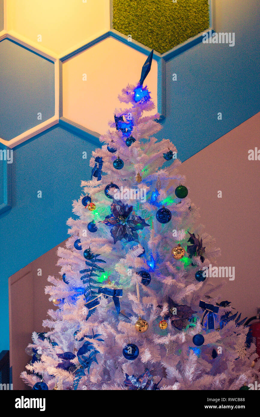 White Christmas Tree With Blue Balls And Twinkling Lights Stock Photo Alamy