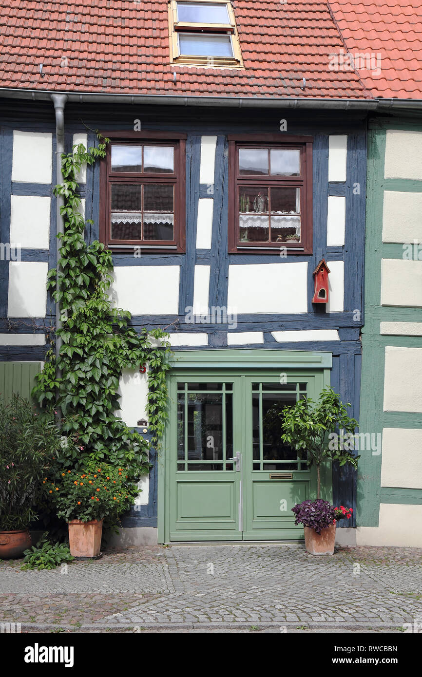 Crooked half-timbered house in the Uckermark in Germany - Stock Image