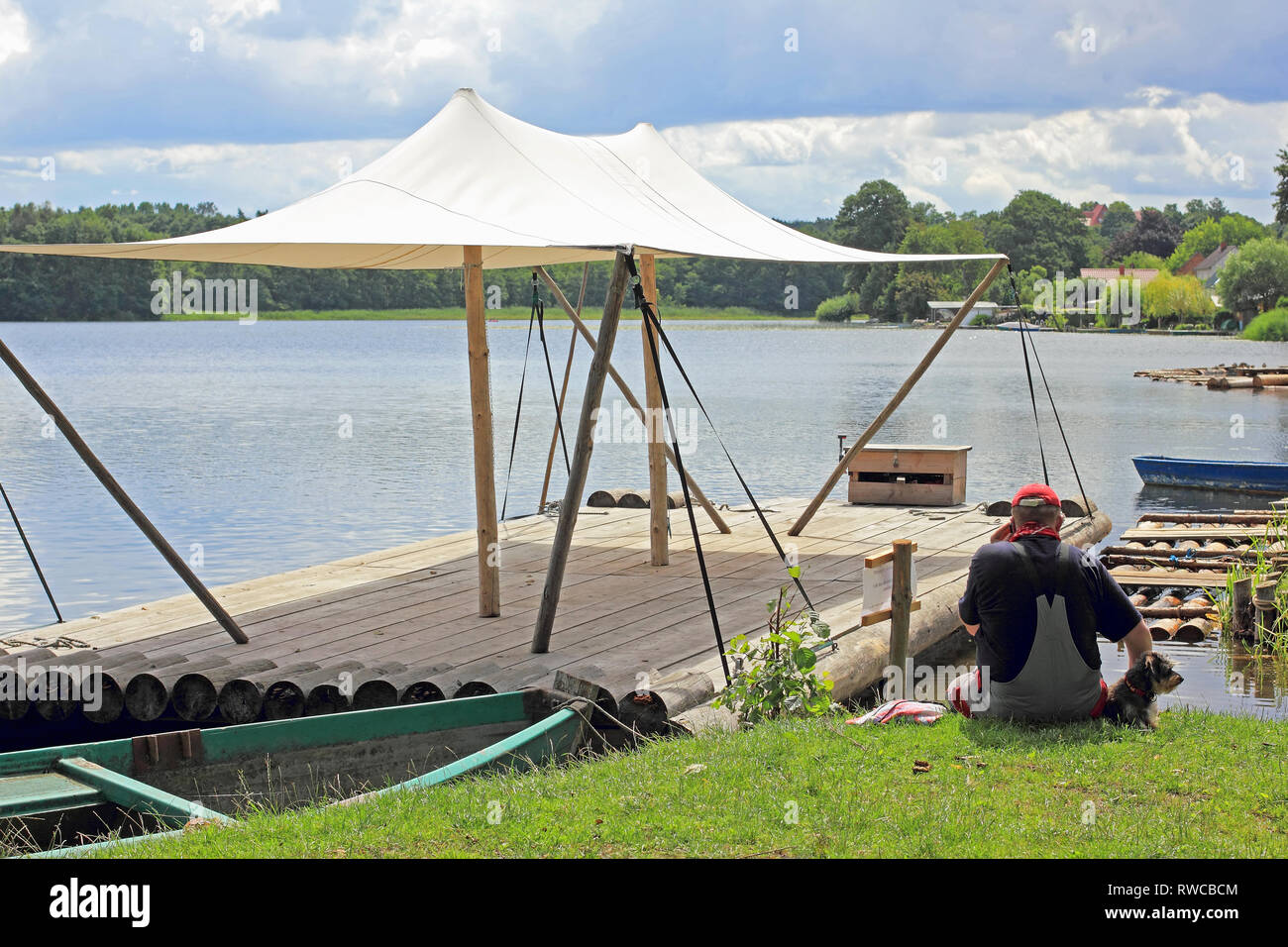 An excursion-raft with awning in Lychen in the Uckermatk in North Germany - Stock Image