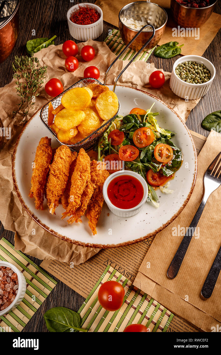 Shrimps Tempura With Spicy Chili Sauce Fresh Salad And Fried Potatoes Pub Food Stock Photo Alamy