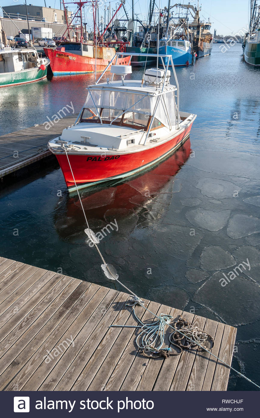 New Bedford, MA, USA - January 12, 2019: Commercial fishing boats docked on Acushnet River in New Bedford with ice floating around the Pal Dao - Stock Image