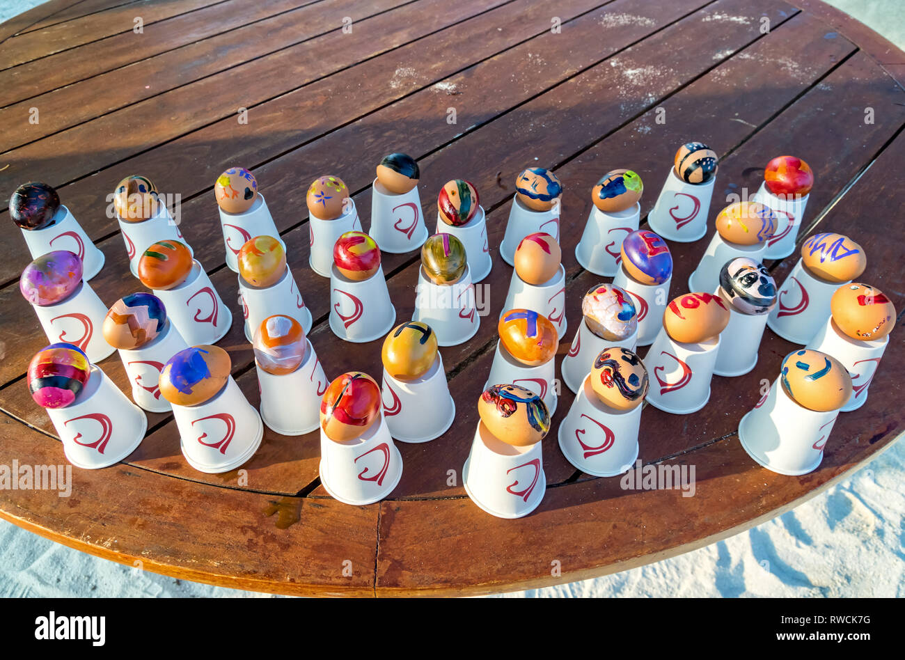 Easter eggs on one of the Maldivian beaches. - Stock Image