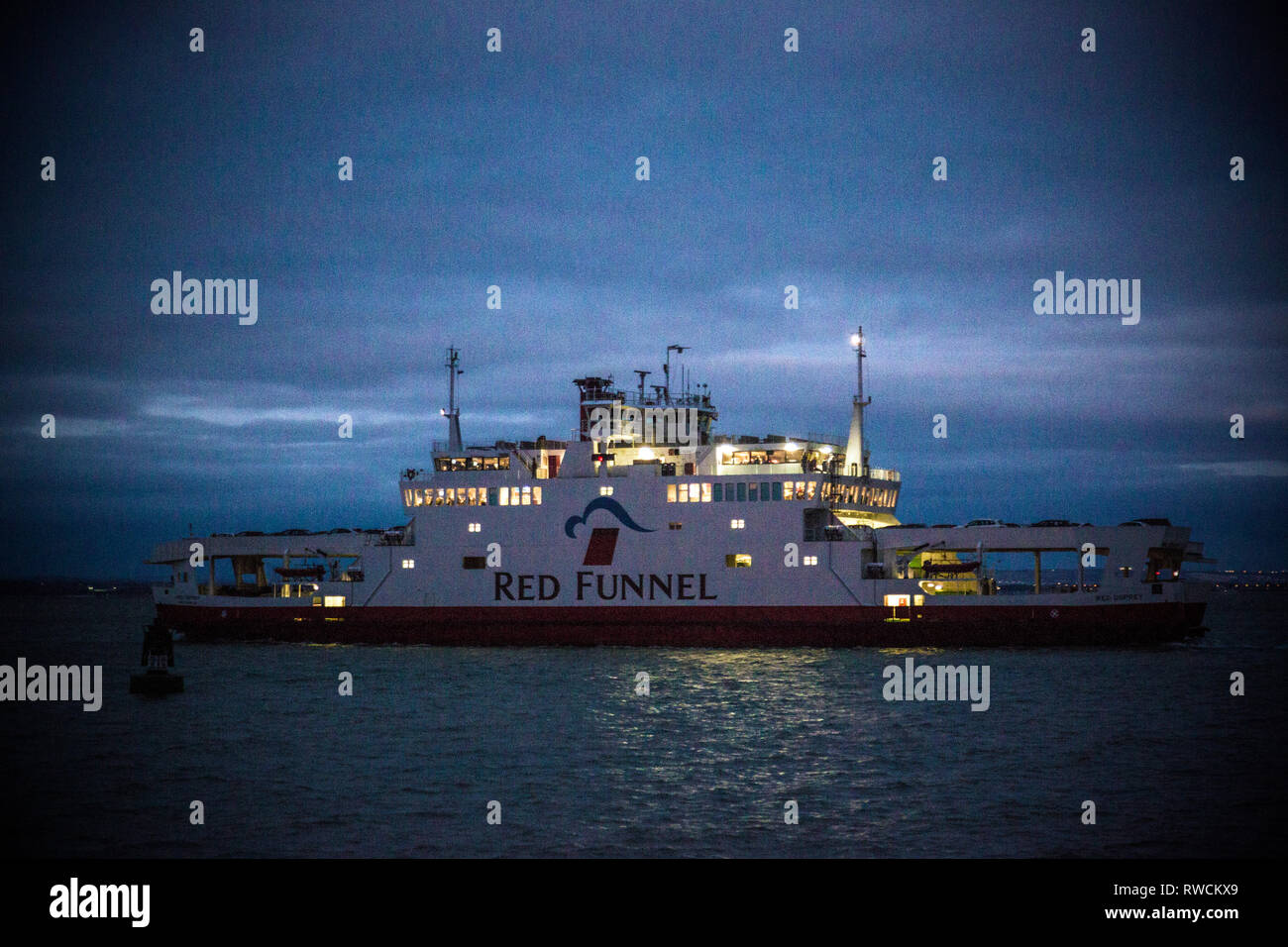 grainy,night,picture,of,Red,Funnel,Car,Ferry,The Solent, Southampton,Cowes,route, East, dusk,lights,navigation,Isle of Wight, England, UK, - Stock Image