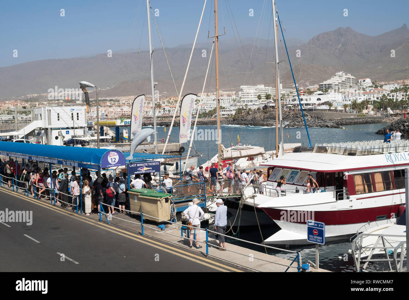 Tourists queuing to board the Royal Delphin catamaran Puerto Colon, Costa Adeje, Tenerife - Stock Image