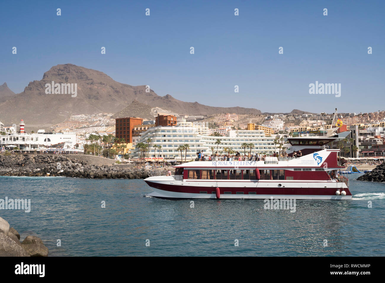 The  Royal Delfin catamaran with submarine vision leaving Puerto Colon with a group of tourists, Costa Adeje, Tenerife. - Stock Image