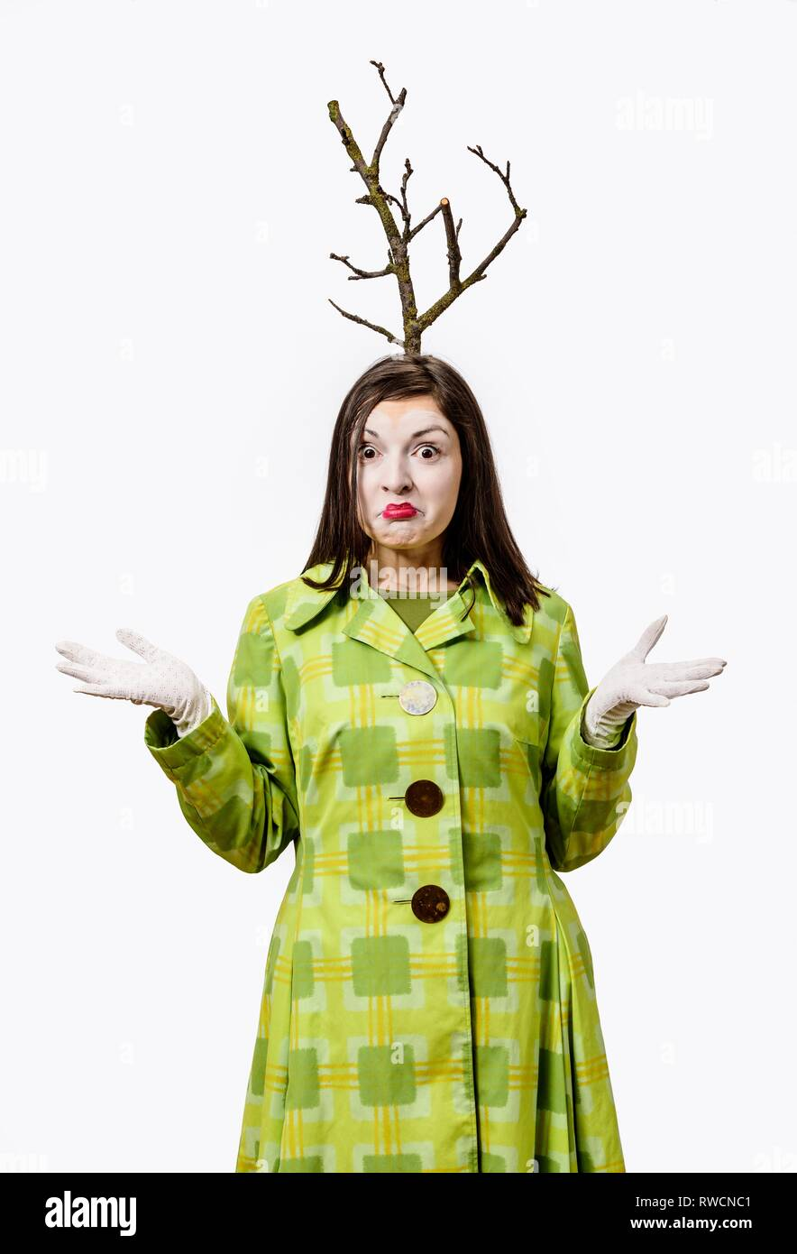 Happy clown standing in suit and a branch grows from his head, isolated on white background. - Stock Image