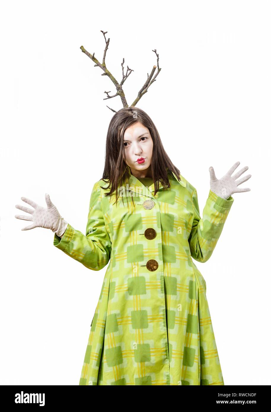Funny mime performing and gesturing isolated on white background, a branch grows from his head. - Stock Image