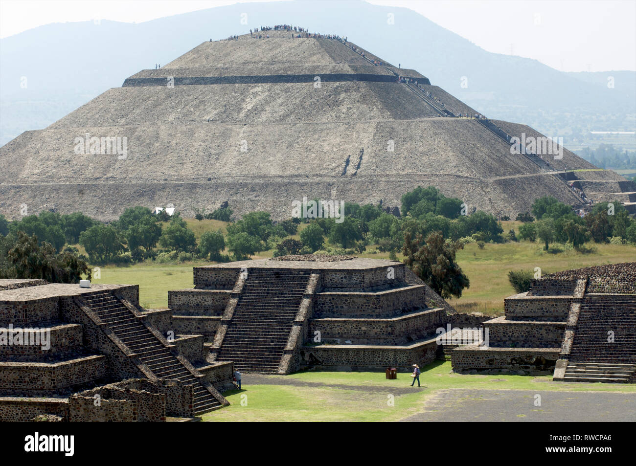 Pyramid of The Sun and the Avenue of the Dead in the distance seen from Pyramid of The Moon at Teotihuacan in the Valley of Mexico in Mexico - Stock Image