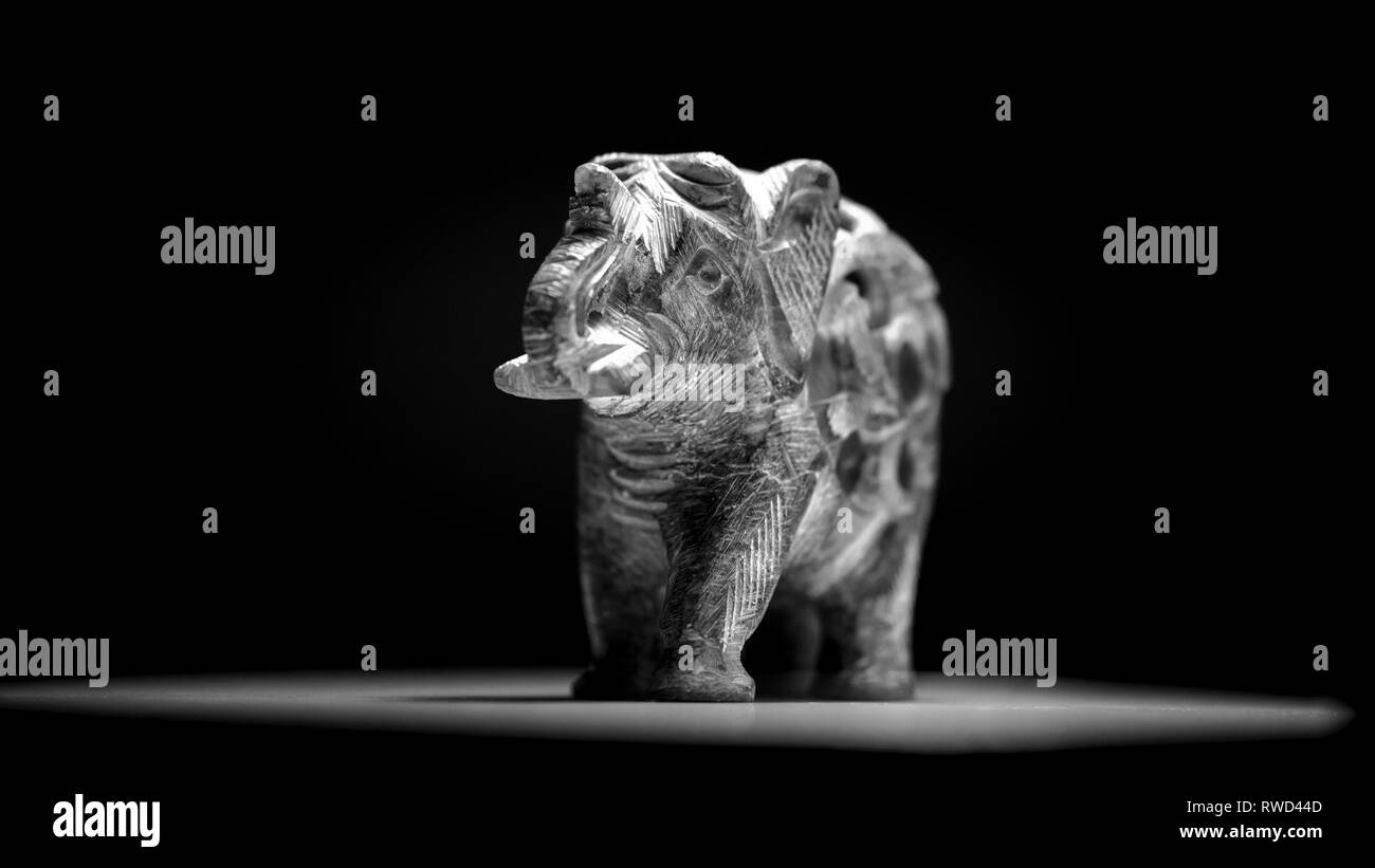 A stone elephant in black and white. - Stock Image