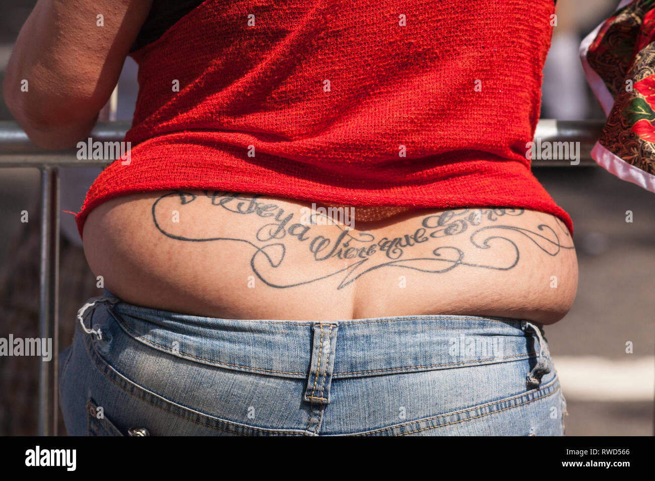 fat hangs as a woman wears her jeans tight at the The National Puerto Rican Day Parade in New York - Stock Image