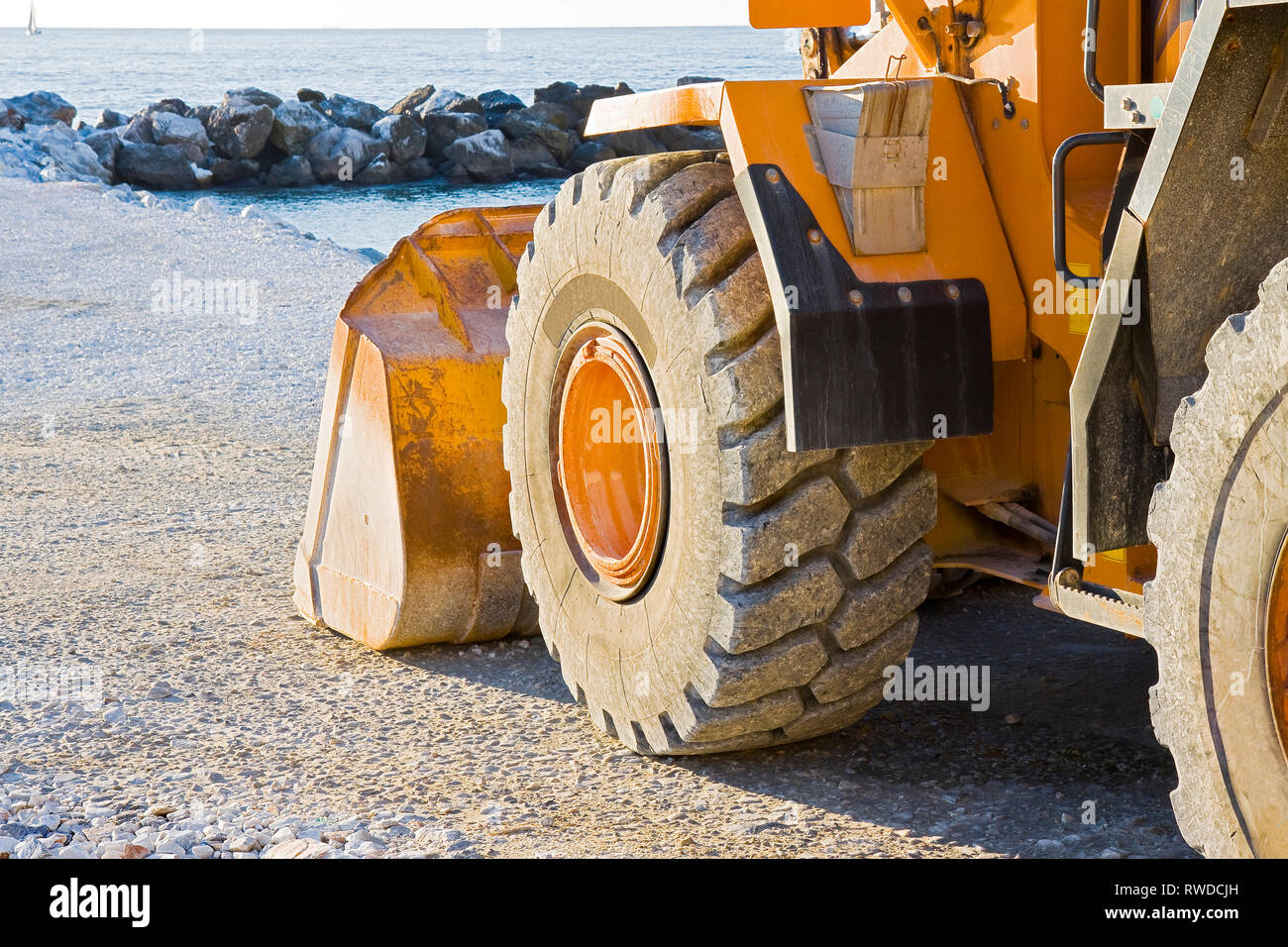 Detail of the excavator's wheel at the seaside - Stock Image