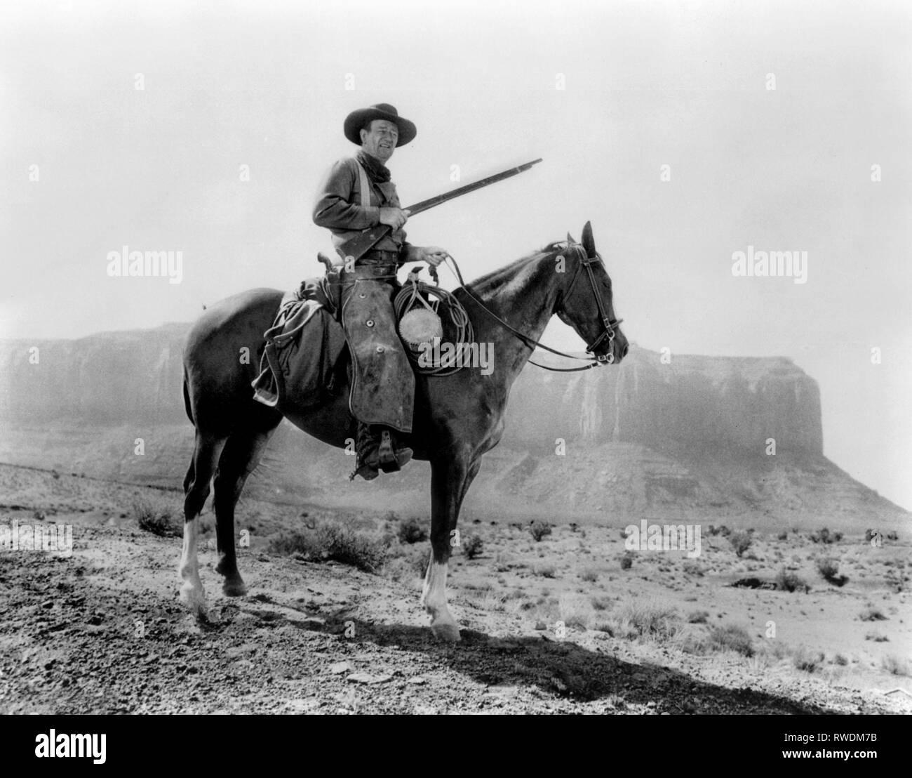 JOHN WAYNE, THE SEARCHERS, 1956 - Stock Image