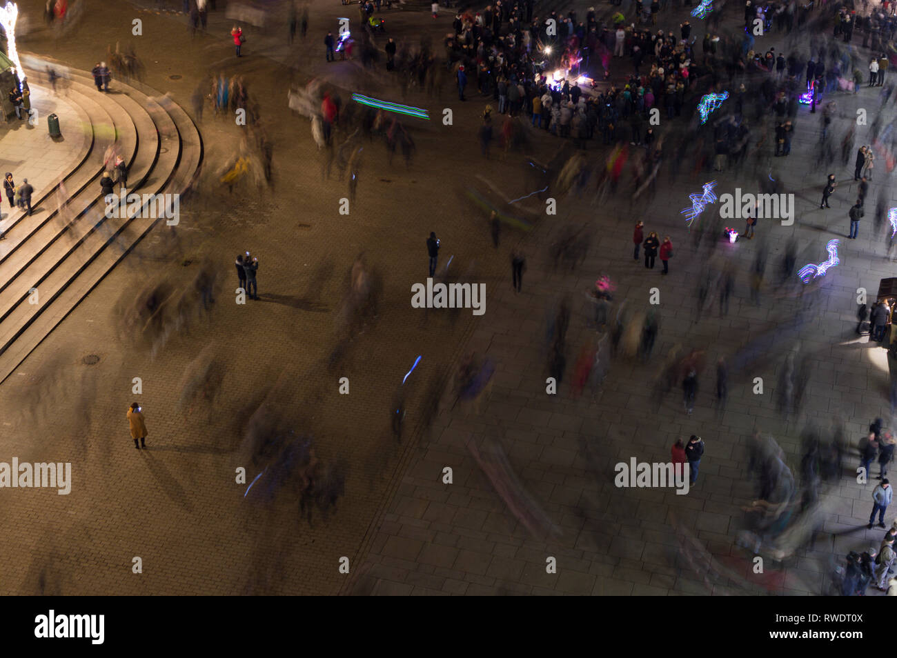 Crowded Main Pedestrian Square in Warsaw, Poland at Night - Stock Image