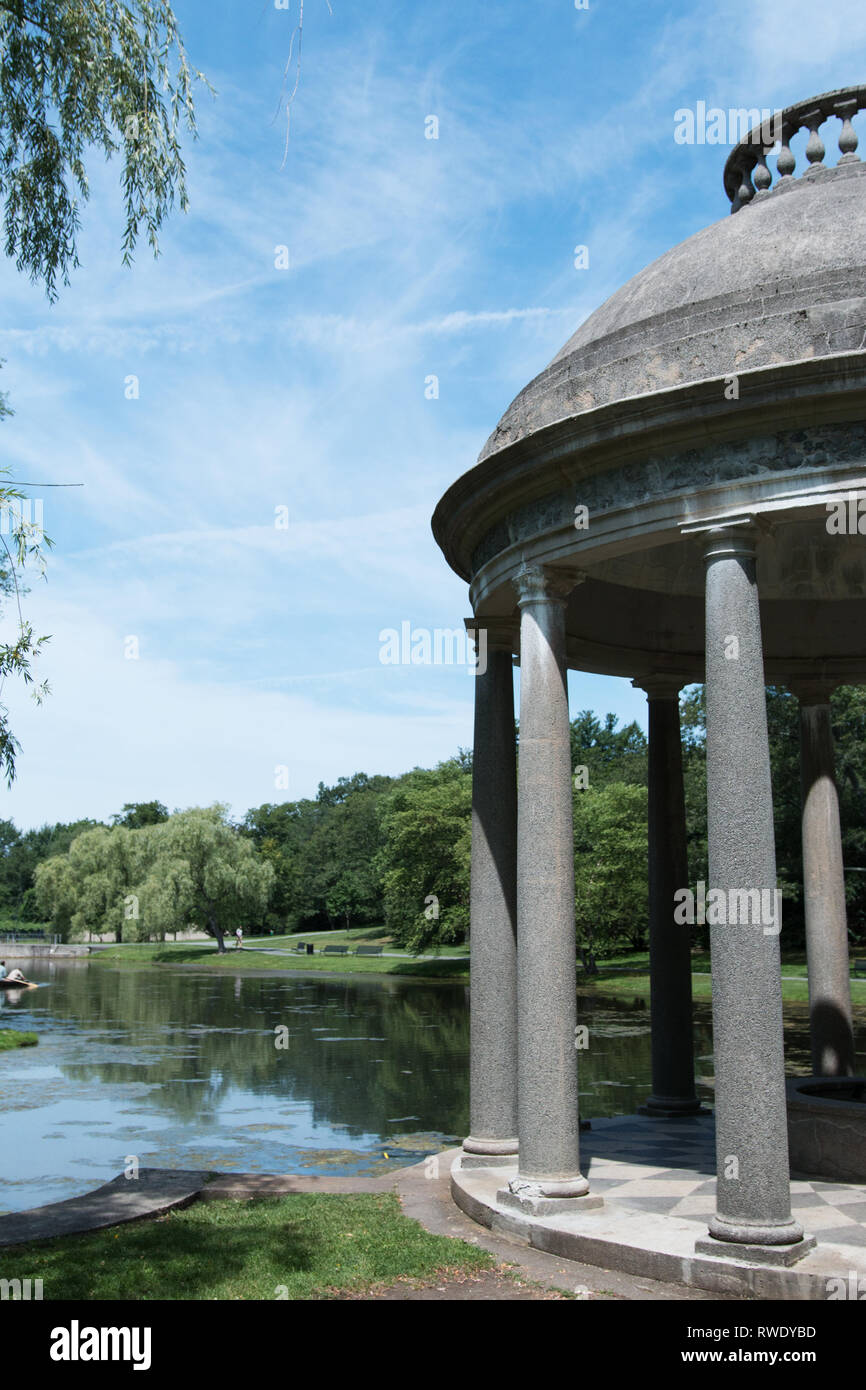 Looking across the lake from the stone gazebo at Larz Anderson Park in Brookline, Massachusetts, USA. - Stock Image
