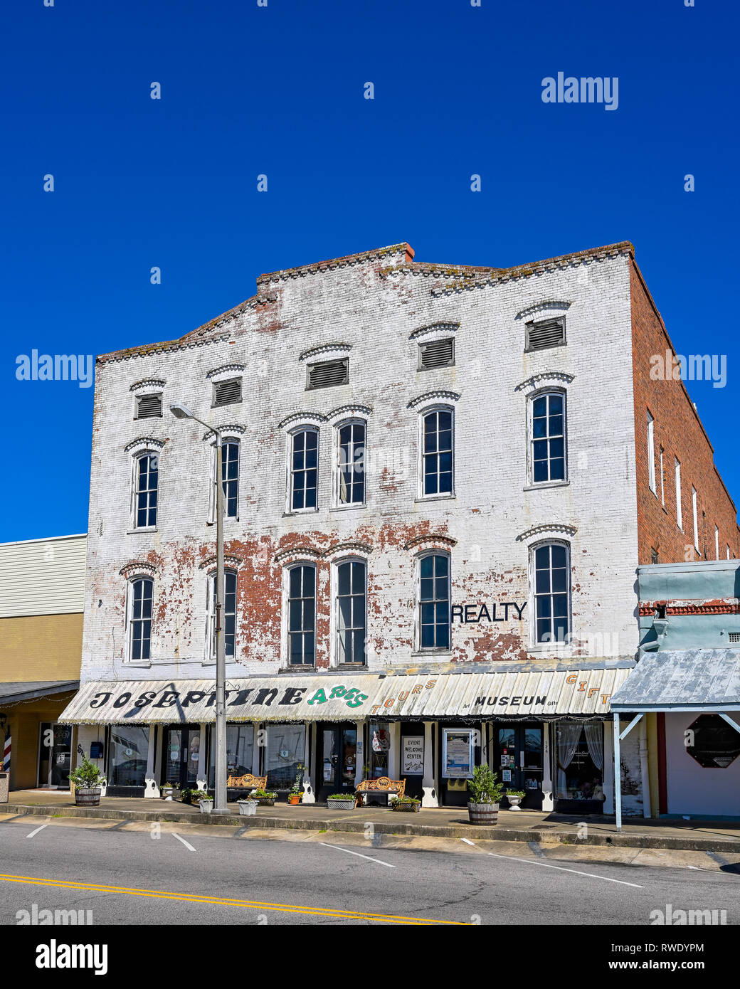 Front exterior entrance showing weathered brick of the old, vintage Josephine Hotel that has now been repurposed, in small town Union Springs AL, USA. - Stock Image