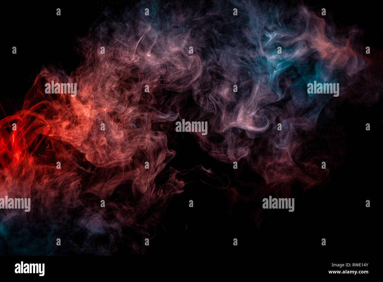 Abstract Art Red And Blue Colored Smoke On Black Isolated