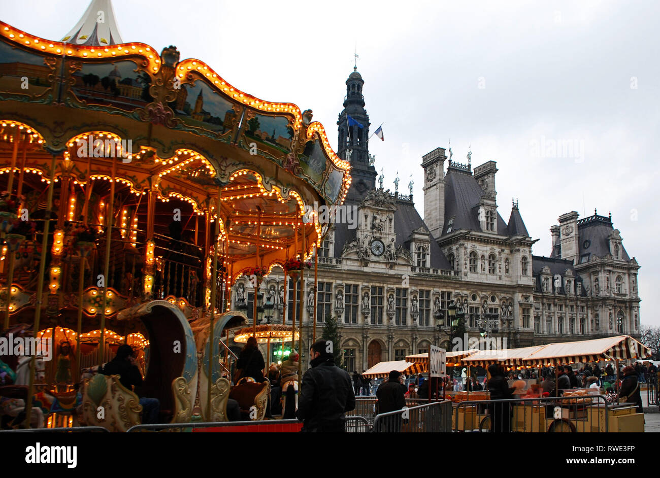 Hotel de Ville with a carousel in christmastime, Paris, France - Stock Image