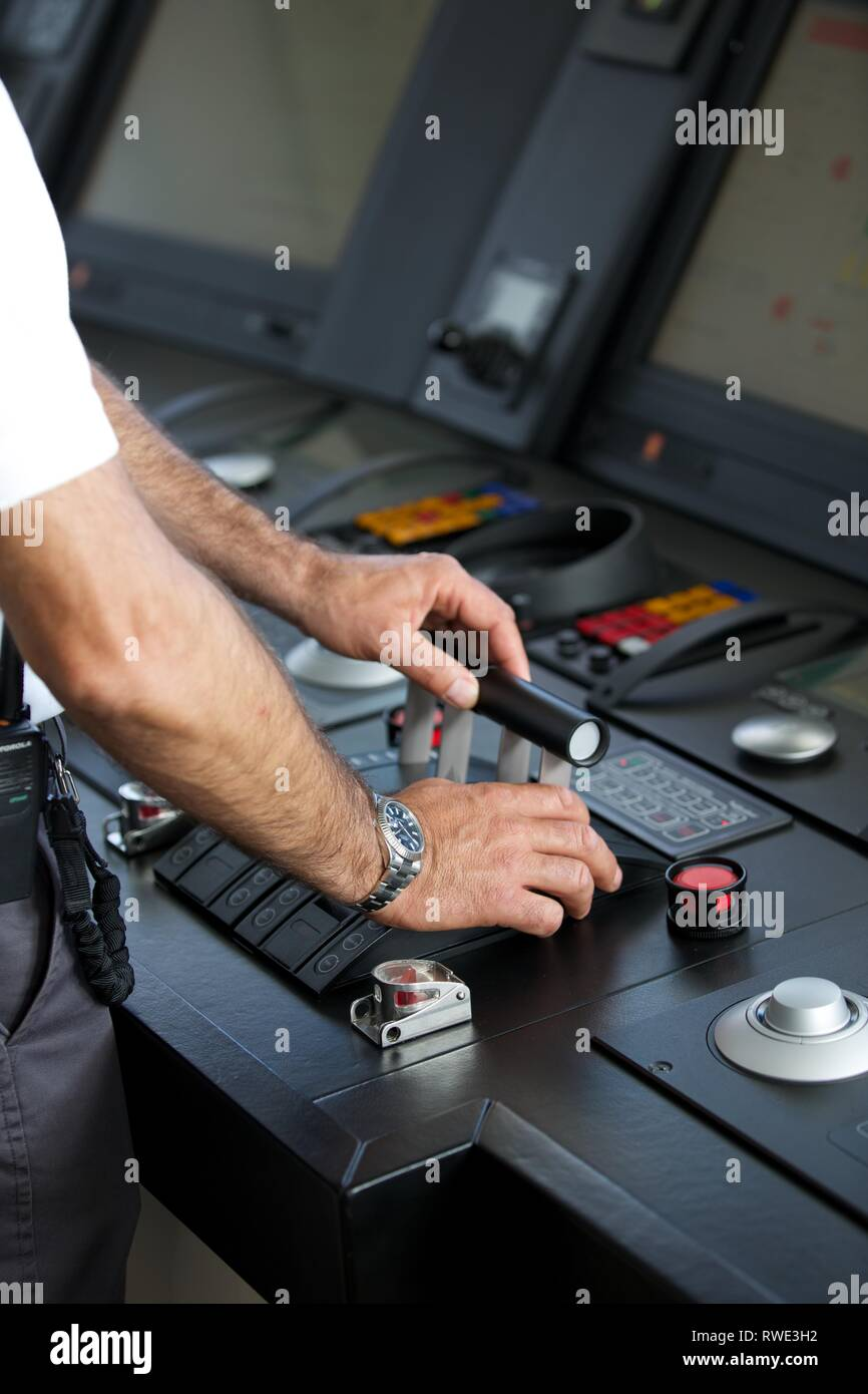 Wide shot of Superyacht command centre with Captain's hands on the throttle Stock Photo