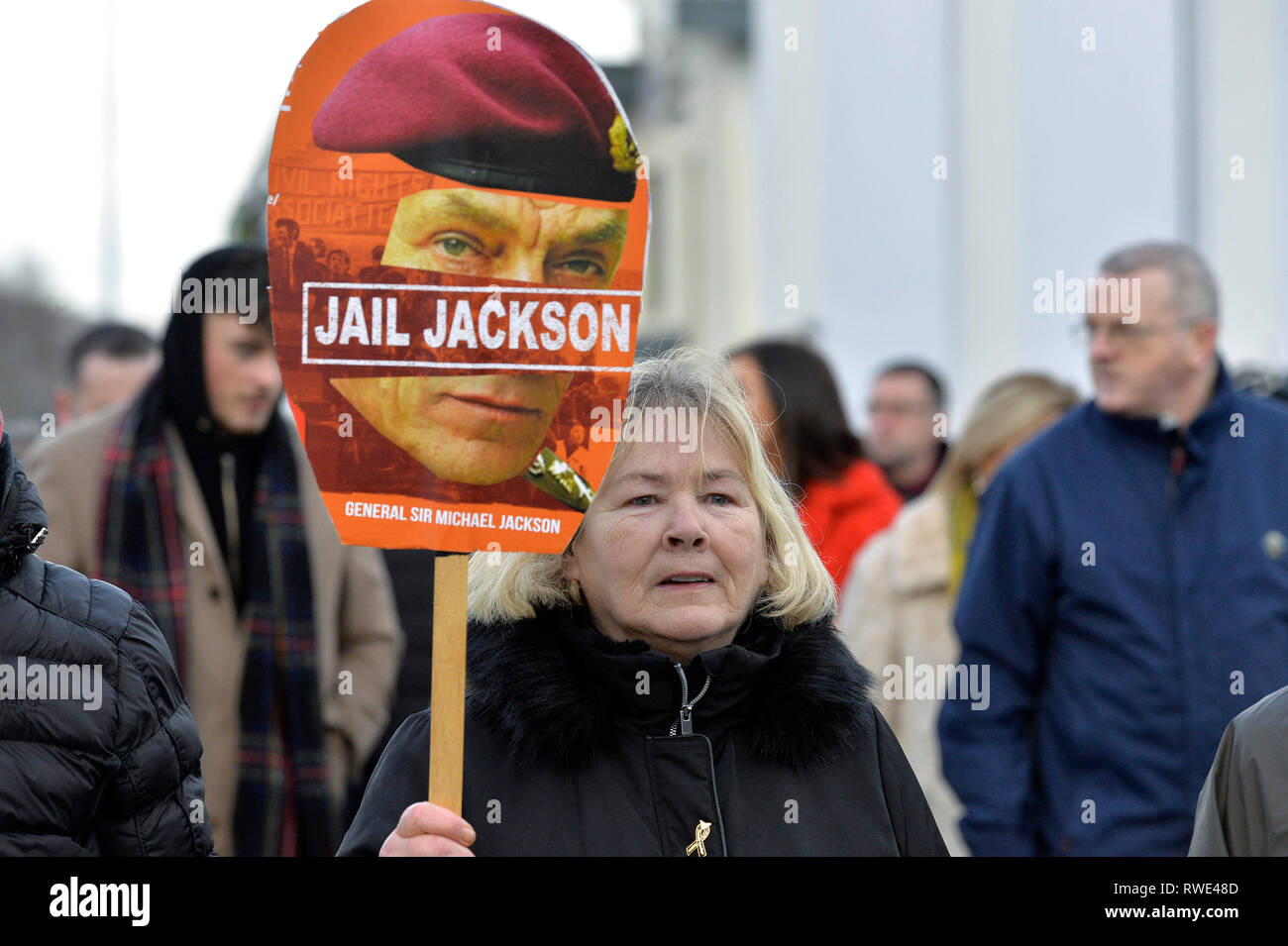 Linda Nash whose brother William was killed on Bloody Sunday 1972 carries a poster, calling for the jailing of General Sir Michael Jackson, at the 47t - Stock Image