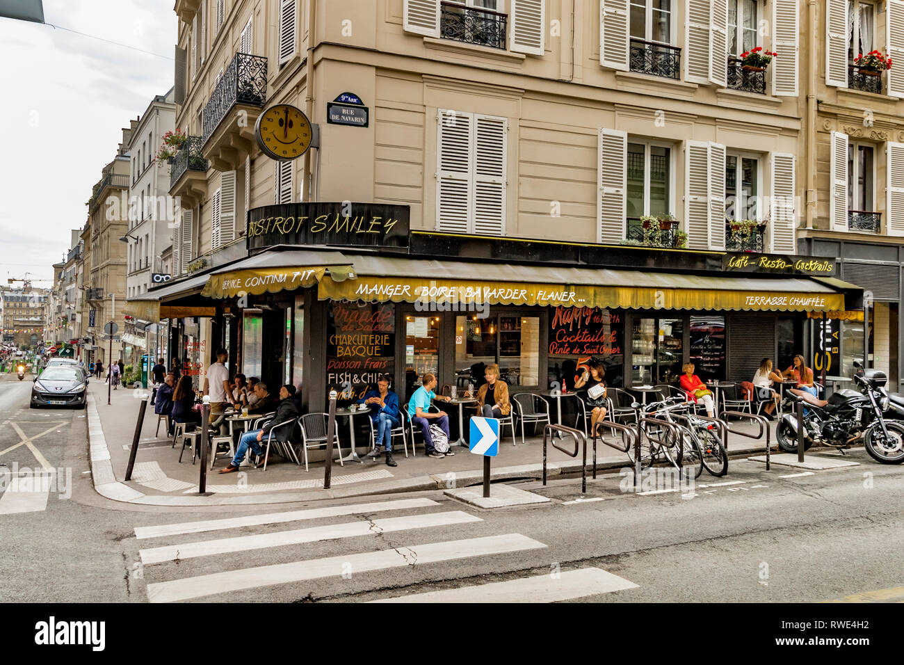 People sitting outside Bistrot Smiley on Rue des Martyrs in the St Georges area of Paris - Stock Image
