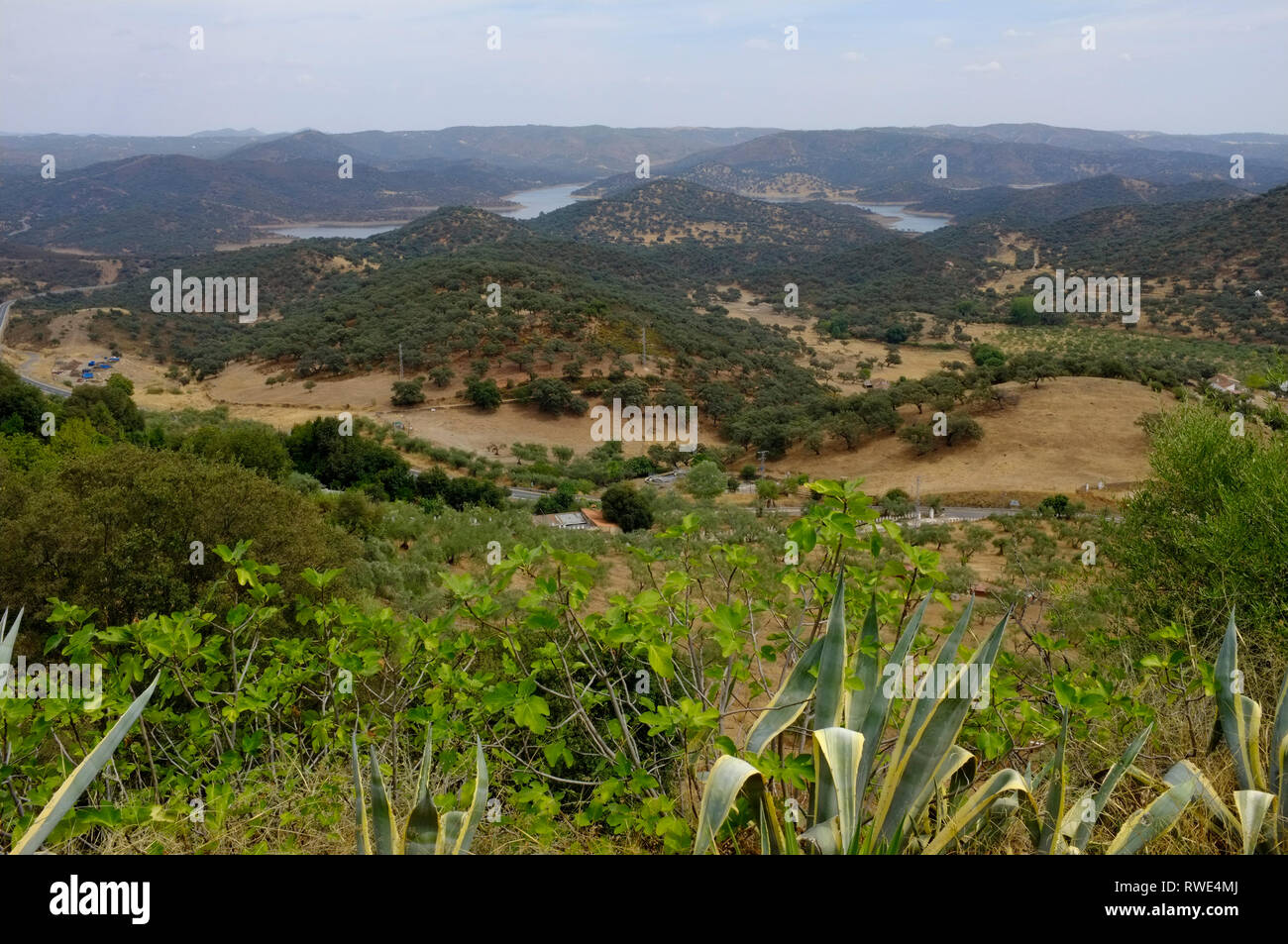 View of Zufre Reservoir and hills in the Sierra de Aracena Natural Park, seen from the hilltop white town of Zufre, Huelva Province, Andalusia, Spain - Stock Image