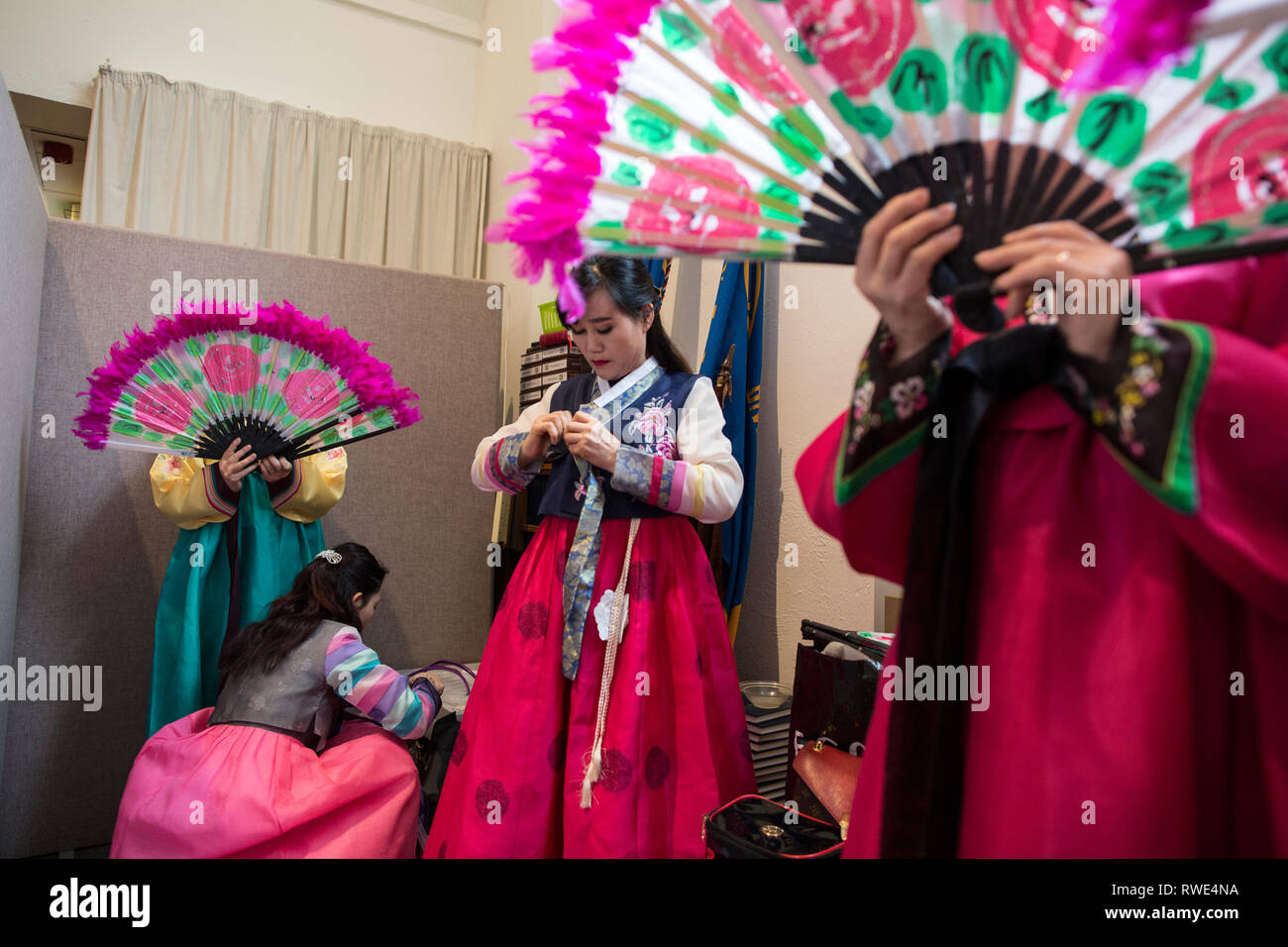 North and South Korean Ladies perform the Buchaechum also called a Fan Dance on the day Korea Commemorates 100th Anniversary of March 1st Independence. - Stock Image