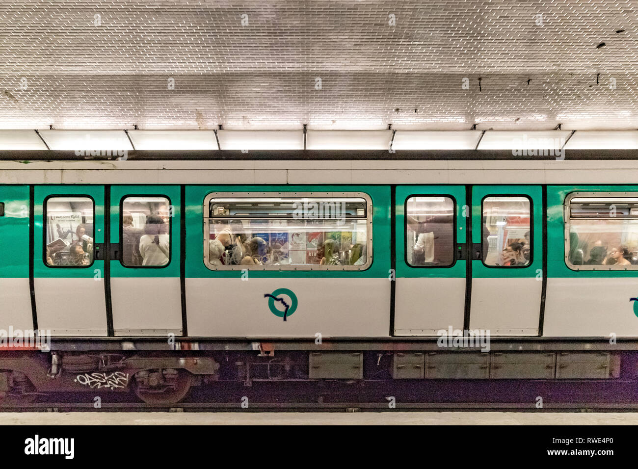 People on a Paris Metro train at St Georges Metro station in the 9th arrondissement of Paris - Stock Image