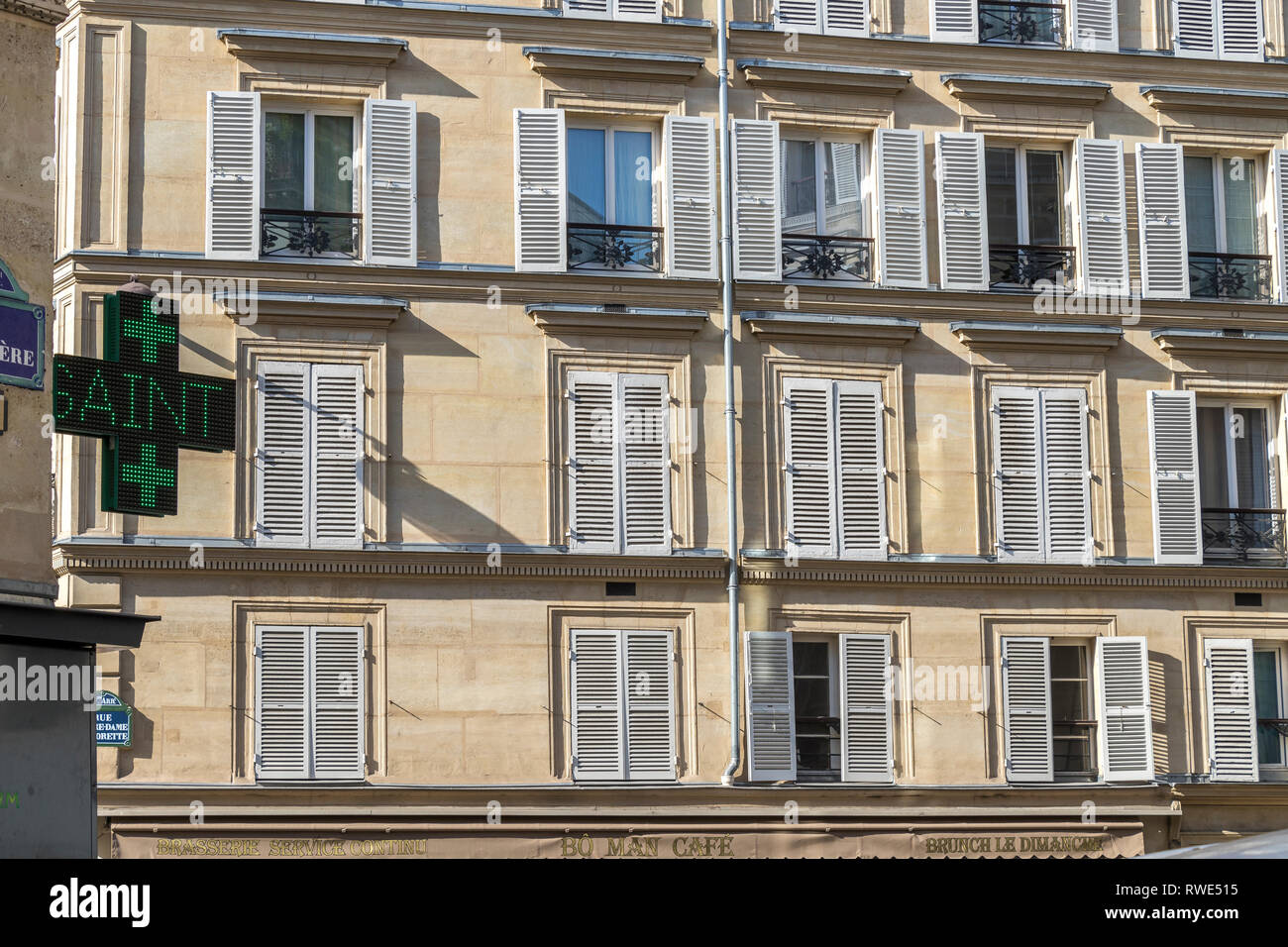 Paris apartments with wooden shutters on the windows in the sunshine ,Rue Notre Dame de Lorette,St Georges in the 9th arrondissement of Paris Stock Photo
