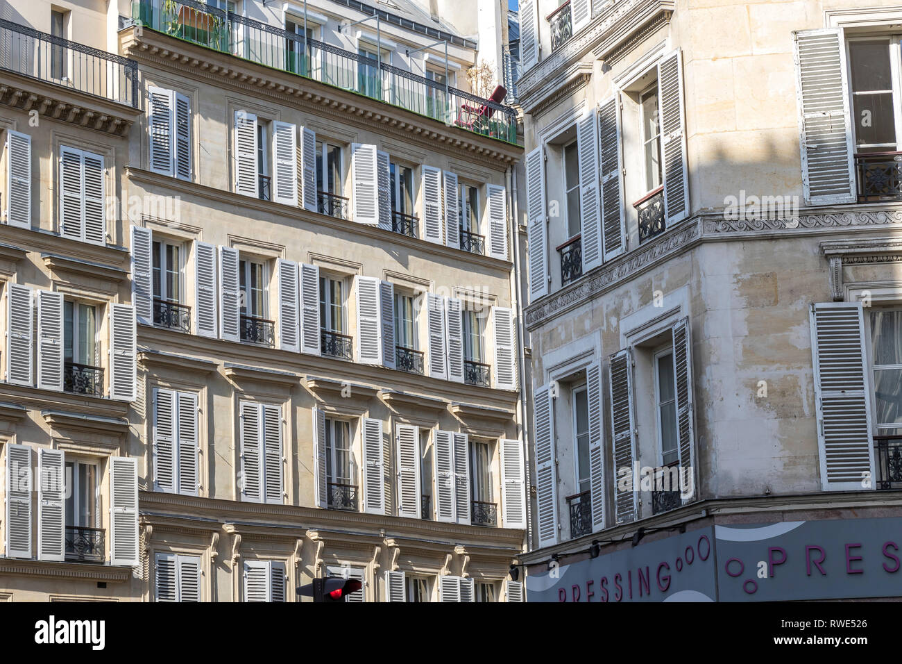 Paris apartments with wooden shutters on the windows in the sunshine ,Rue Notre Dame de Lorette,St Georges in the 9th arrondissement of Paris - Stock Image