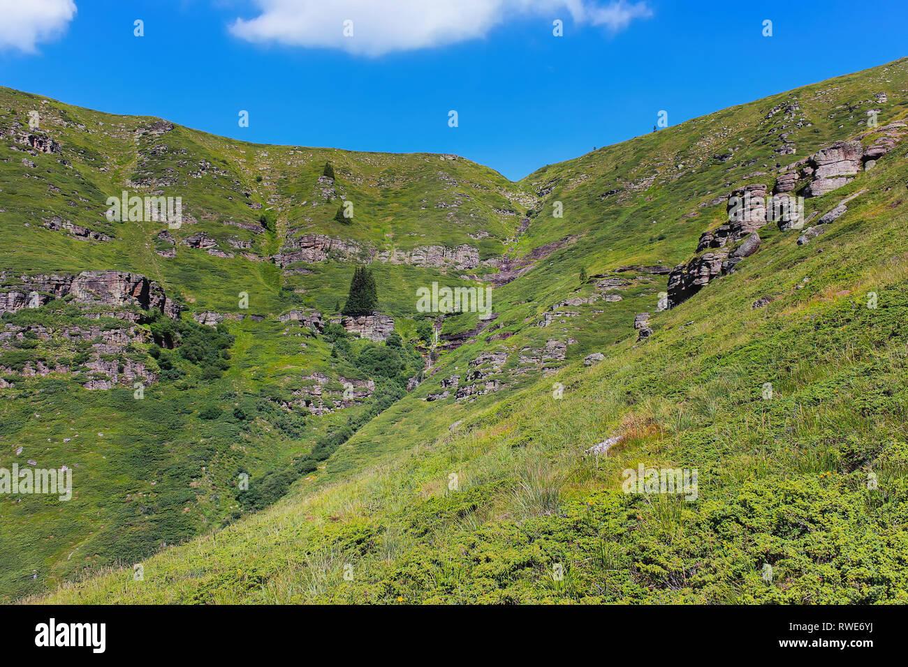 Alien, rocky, sunlit landscape and almost dried up Kopren waterfall on Old (Balkan) mountain in Serbia - Stock Image