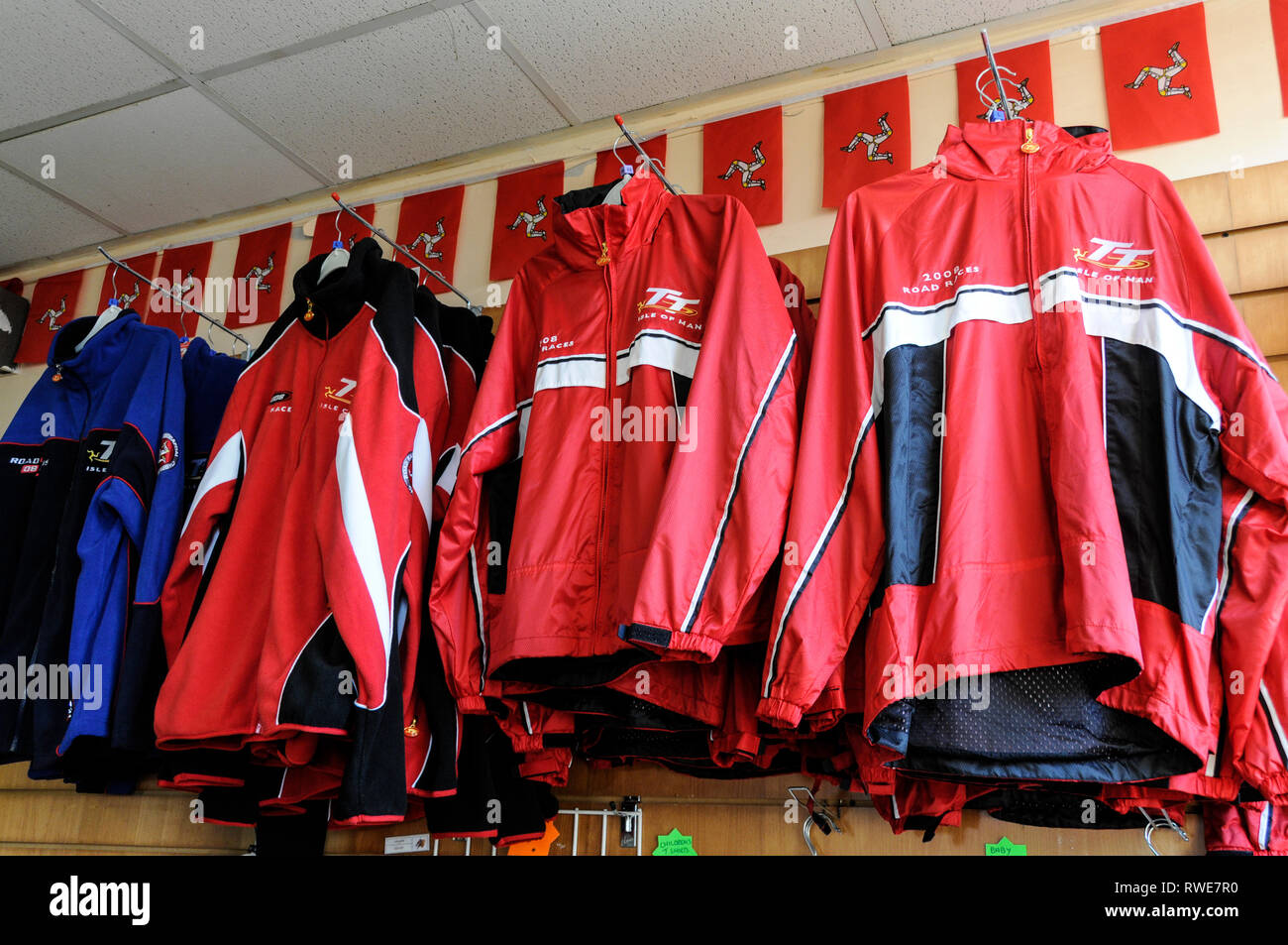 A range of souvenirs and clothing of the famous TT races on sale at the Summit Cafe on Mount Snaefell, the island's highest point on the Isle of Man,  - Stock Image
