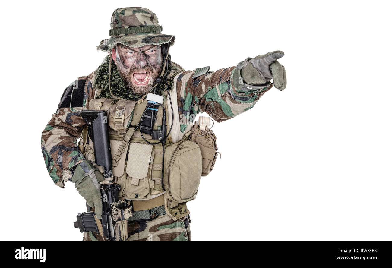 Studio shot of U S  soldier yelling and pointing finger to