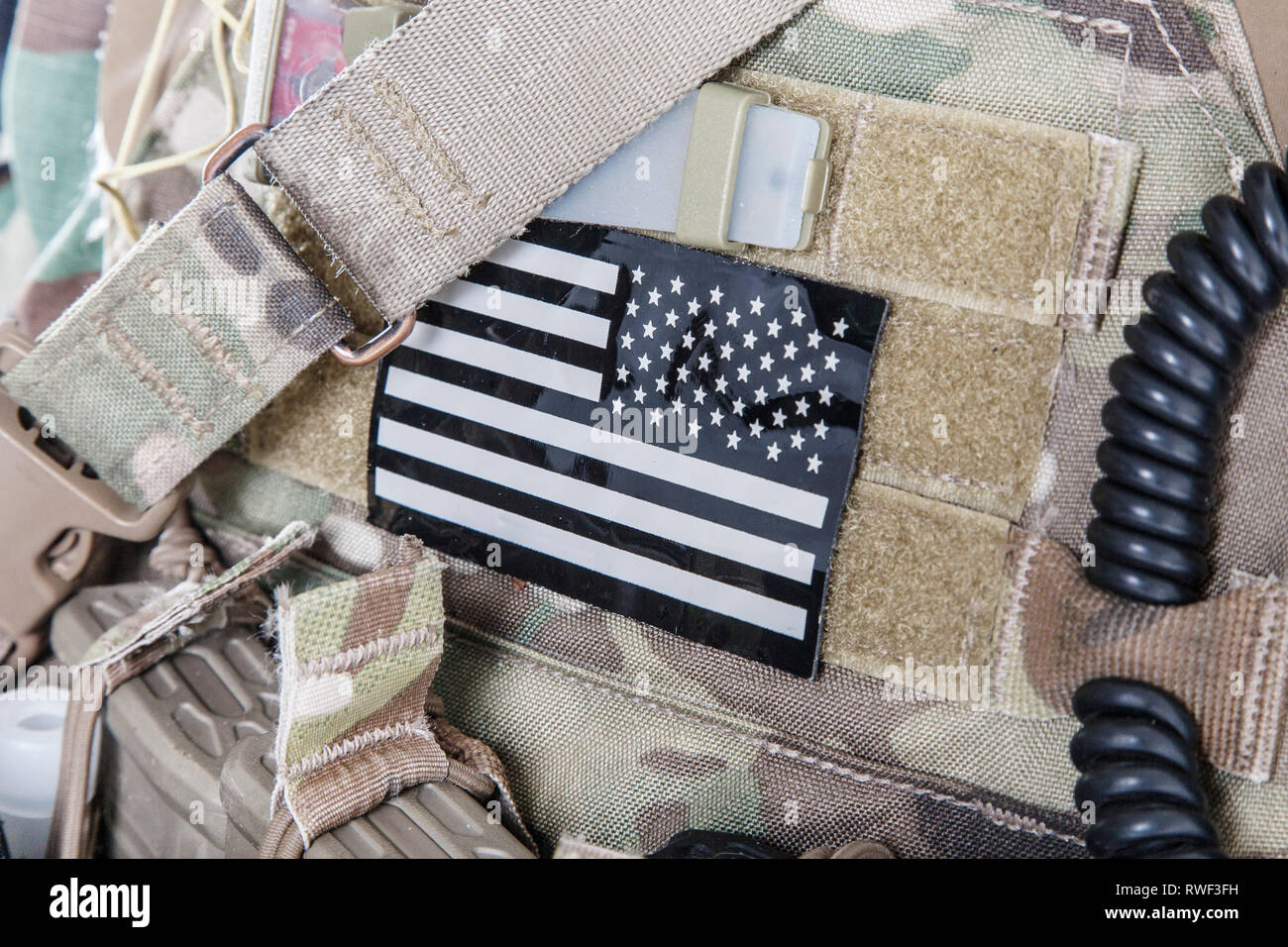 American flag military patch on camouflage uniform of U.S. Armed Forces. - Stock Image