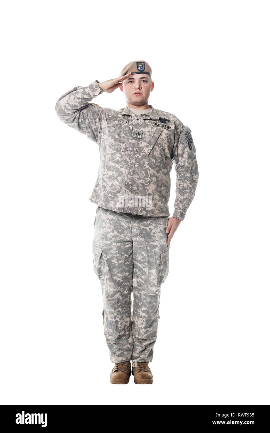 Army Ranger from Special Troops Battalion standing at attention and saluting proudly. - Stock Image