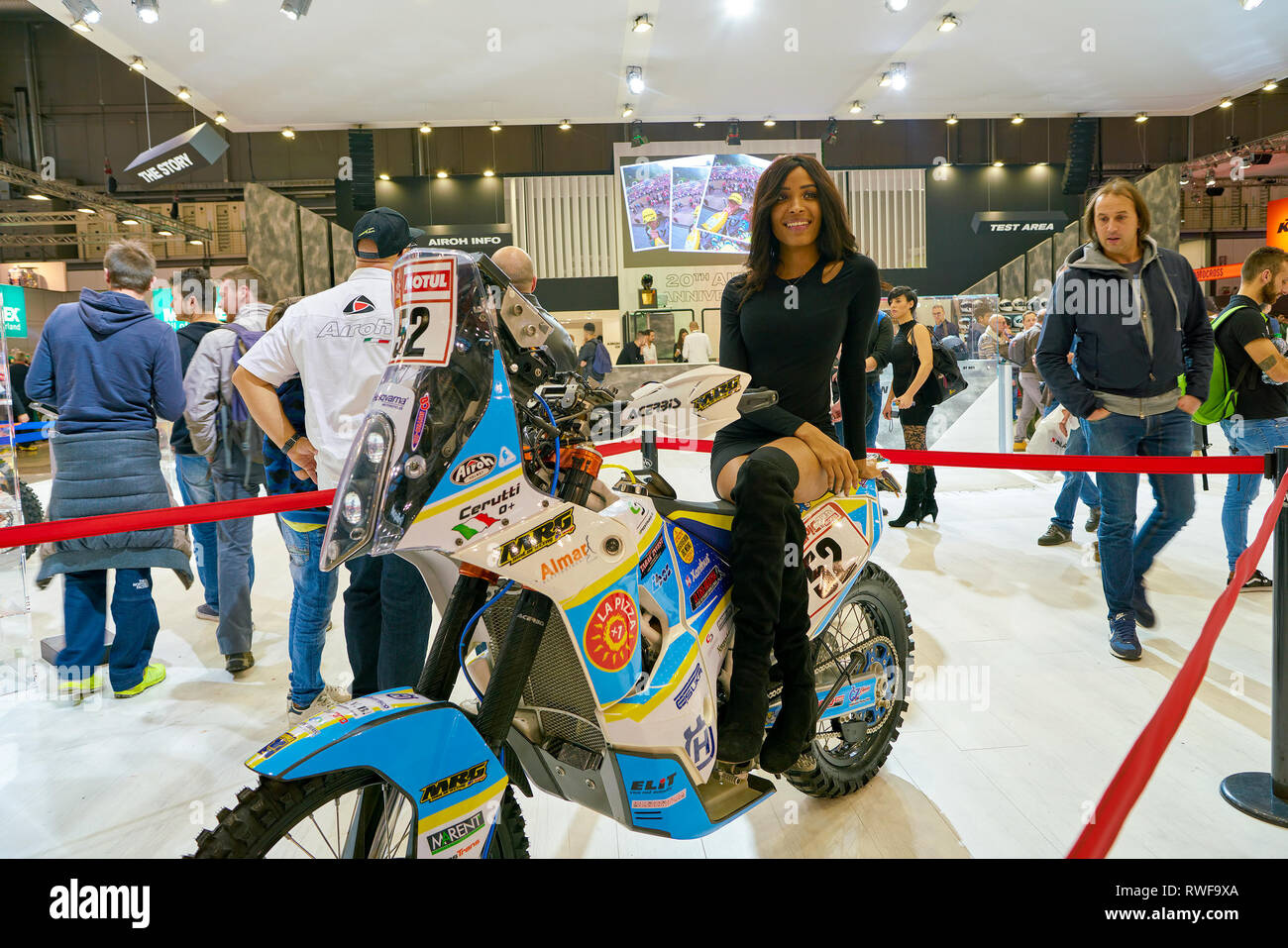 MILAN, ITALY - NOVEMBER 11, 2017: a model poses for the visitors during the EICMA 2017 - 75th International Motorcycle Exhibition. - Stock Image