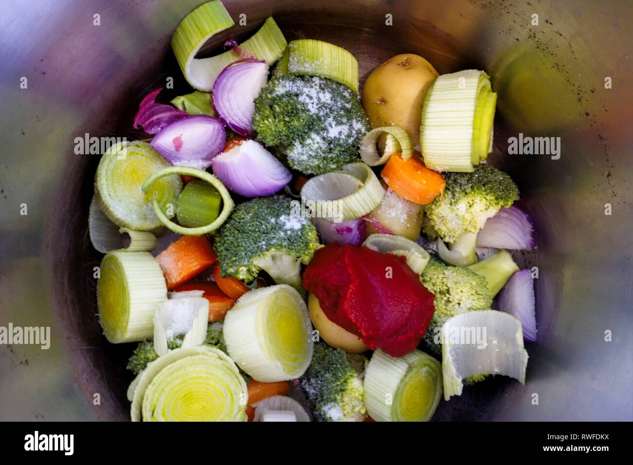 Preparation of Mixed Vegetables to be cooked as a Casserole in a Pressure Cooker - Stock Image