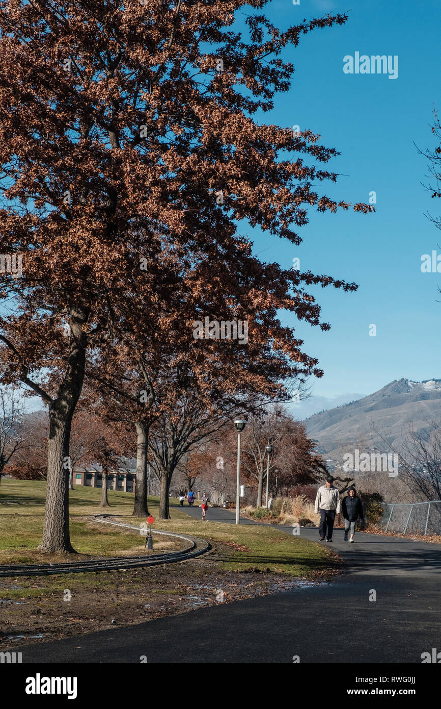 The Chelan County Public Utility Department the team managing the hydroelectric dams and electrical grids in the Wenatchee Valley, as well as the parks, potable water and waste water plants.  A walking and biking trail parallels the river on both sides for many miles. - Stock Image