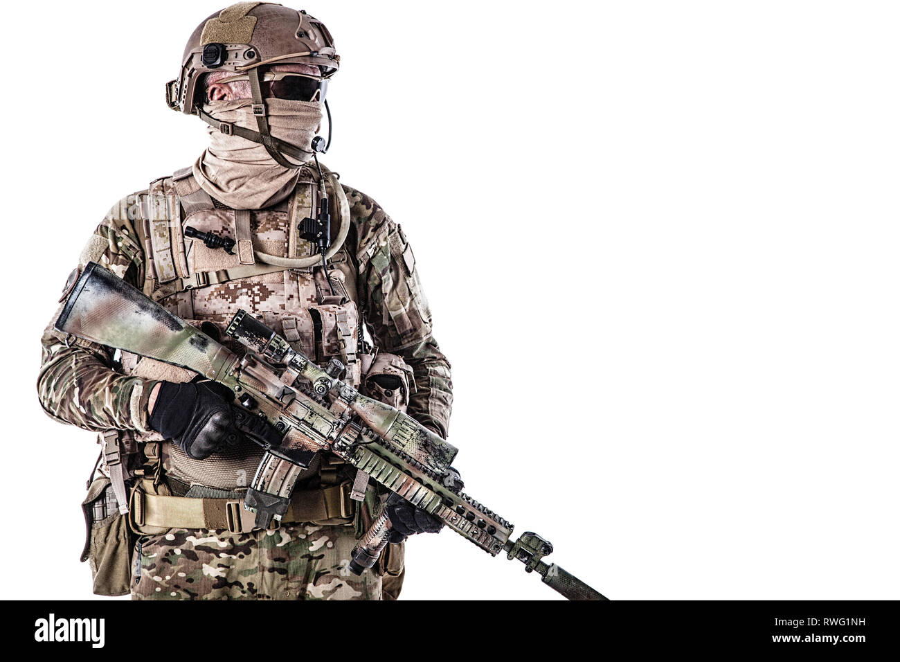 Half length portrait of special forces soldier in field uniform with weapon. - Stock Image