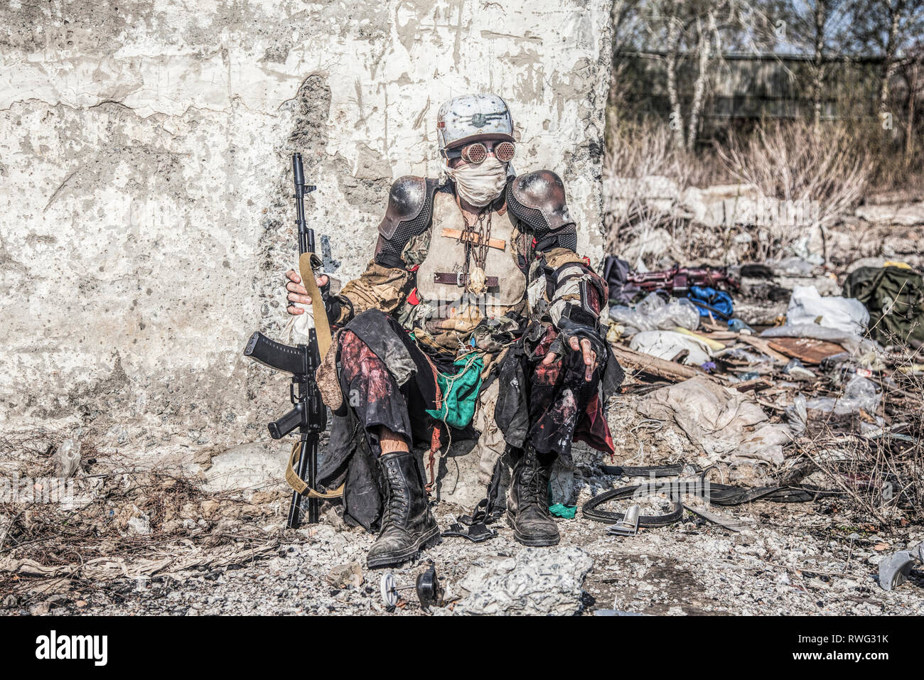 Post apocalyptic survivor creature with homemade weapons. - Stock Image