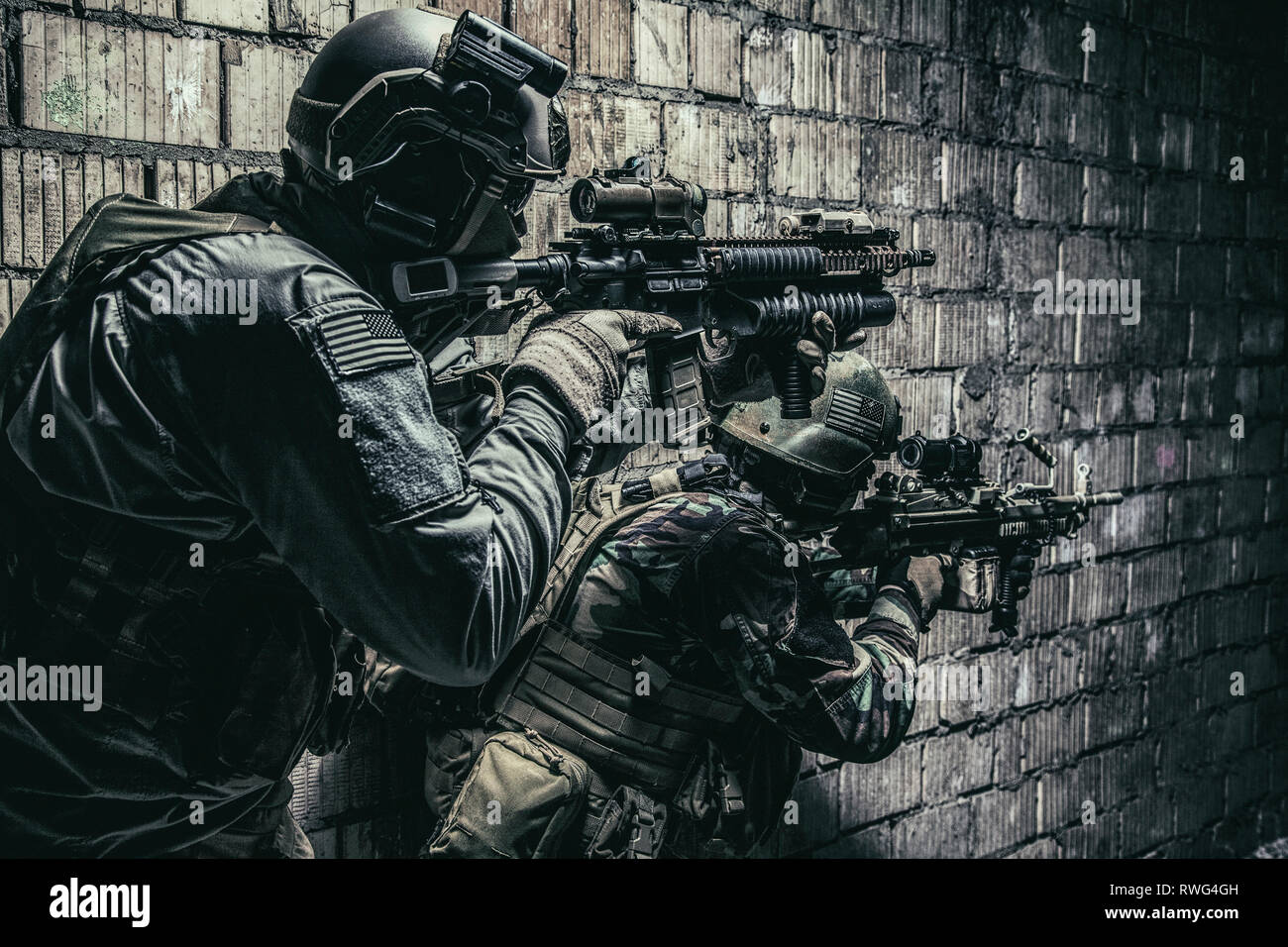 Pair of soldiers in action under the cover of darkness. - Stock Image