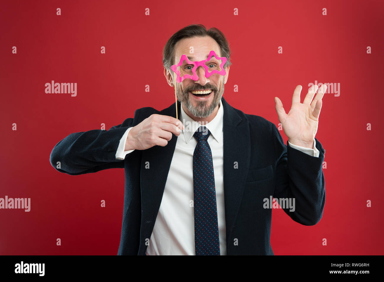 Cheerful businessman in party photo booth props. Guy enjoying party carnival. Holiday party celebration. Having fun. Office party corporate. Join carnival. Man formal suit wear fake glasses accessory. Stock Photo