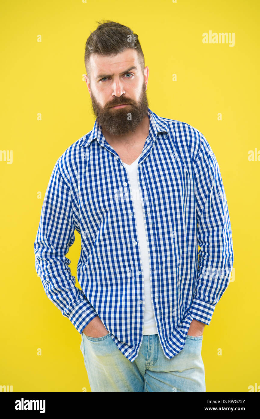 Having some doubts. Beard fashion and barber concept. Man bearded hipster beard yellow background. Barber tips maintain beard. Stylish beard mustache care. Hipster appearance. Emotional expression. - Stock Image