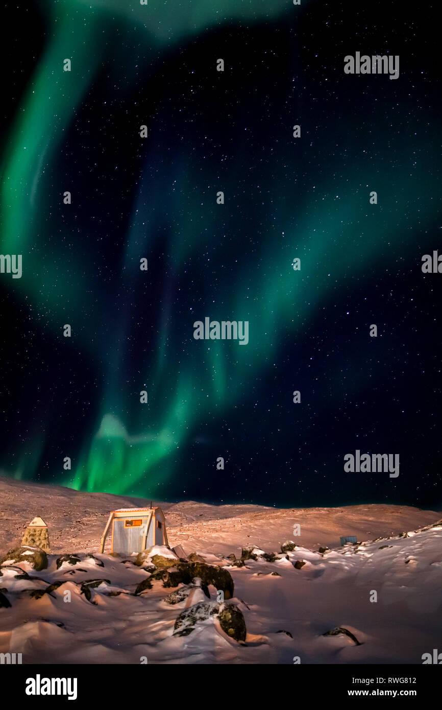 Aurora Borealis dance over the camping area behind Pangnirtung - Stock Image