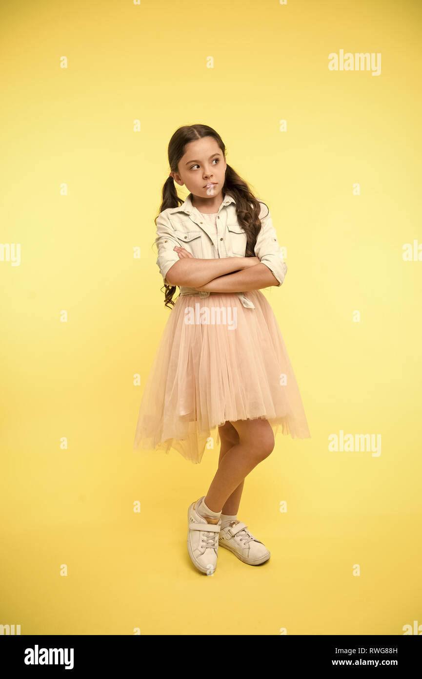 Fashion model agency for kids  Child keep arms crossed on yellow